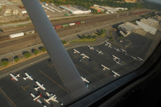 There's a wide choice of schools aircraft types at GA and other airports. Cessna 172 flying over a flight school.