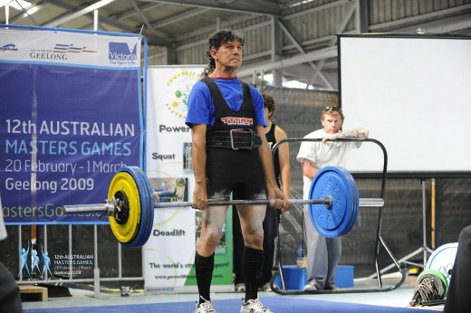 An athlete is performing a deadlift