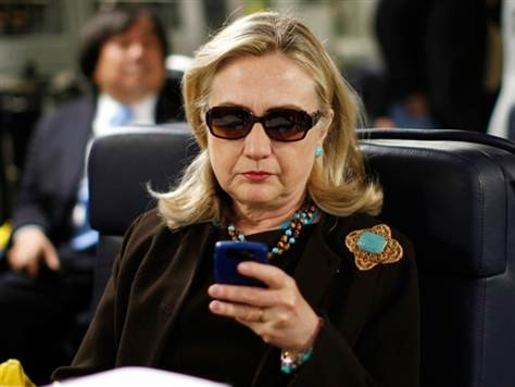 Hillary Clinton checking emails