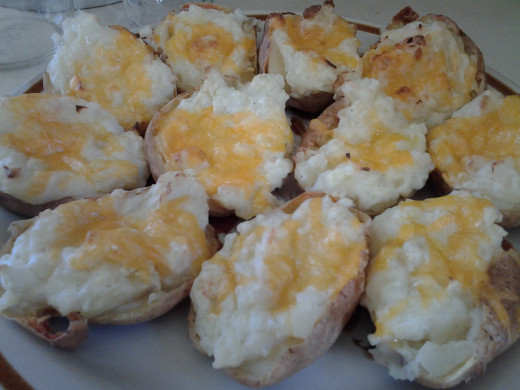 'Twice Baked' potatoes loaded with sour cream and cheddar cheese.