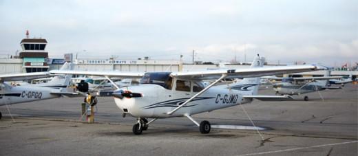Cessna 172 parked at flight training school ramp