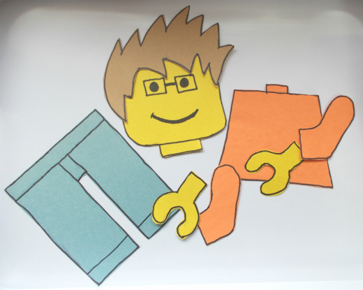 Make minifigure pieces out of construction paper for a Pin Together the Minifigure game.