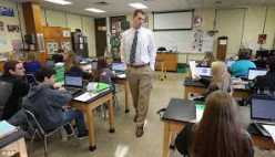 A substitute teacher does his job to keep order in his classroom