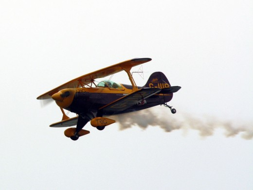 Pitts Special S-2B  is the world's leading high performance aerobatic Biplane performing at a local airport festival.