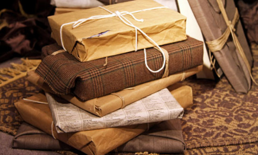 wrapping gifts is a fun way to recycle and reuse paper and fabric