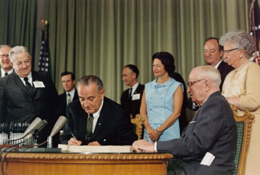 President Johnson signing Medicare into law, 1965.