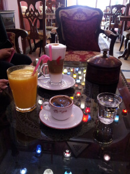 Natural squeezed orange juice, strong Turkish coffee and artistic late
