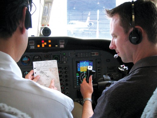 Checking flight weather and requesting control tower permission for the taxi-departure.