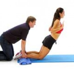 hamstring exercise with a personal trainer