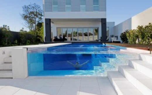 amazing swimming pool with a glass edge