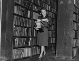 """This librarian, working in 1964, is checking """"due"""" dates of her books"""