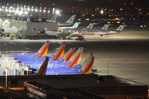 Southwest , American, AirTran  Airlines praked at lambert st louis airport, domestic terminal.