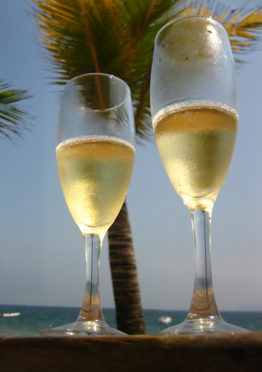 Champagne glasses are upright and narrow with high stem.