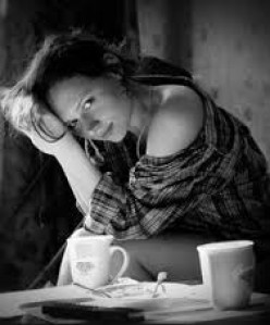 This photo of this gorgeous woman looks more alluring with a cup of coffee in the shot rather than a beer can sitting on the table