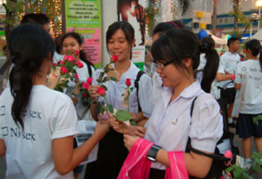 Students making plans to see the guys they are into relationship with. The are holding flowers which they are to give to their love.
