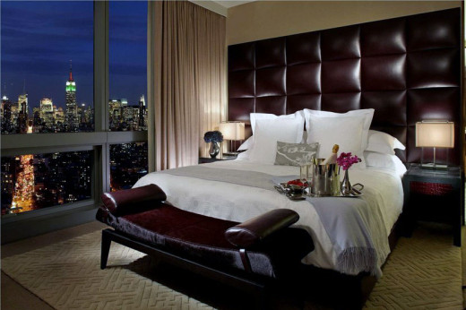 Hotel use of wall panels to elevate luxury rooming.
