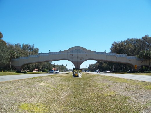 Golf cart bridge over US 27/441.  The Villages development began life as a mobile home park.  It is now the fastest-growing small city in the USA and immensely popular with retirees looking for some sunshine.  There are disadvantages also, however.
