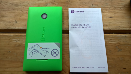 Instruction leaflet and back of Lumia 435