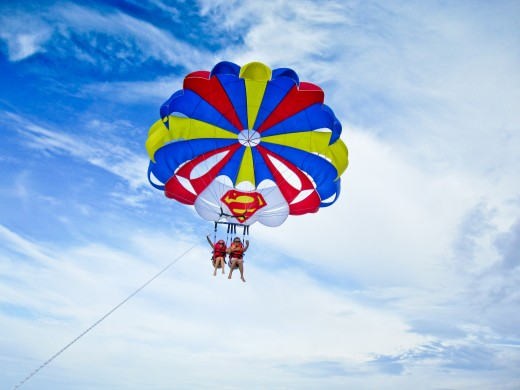 Fly through the sky by parasailing
