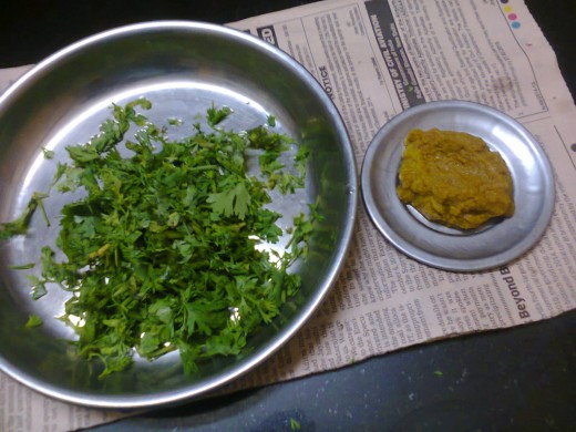 Coriander leaves sliced and chilli- ginger paste preparation done