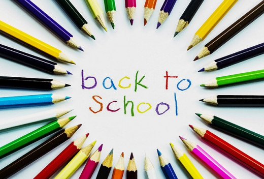 colorful poster of back to school with multi colored pencils in a circle