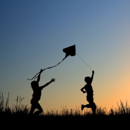 Another sign of spring's warmer weather--kids outdoors flying kites!