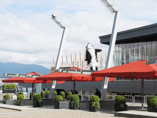A scene in front of the wooden picnic pavilion created for TED 2015. The killer whale in front of the pavilion is the digital orca sculpture by Douglas Coupland.