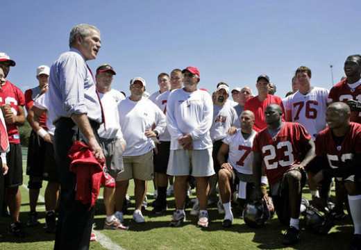 President George W. Bush visiting the Tampa Bay Buccaneers at practice before their game against the Panthers.  The Bucs are currently members of the South Division of the National Football Conference (NFC) in the National Football League (NFL).