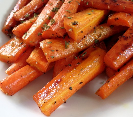 Baked honey carrots with herbs is a wonderful dish that showcases the color, texture and sweetness of carrots when cooked.
