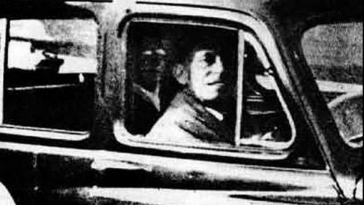 In 1959, Mabel Chinnery spent the day visiting her mother's grave. Afterwards she took this photo of her husband waiting in their car. The ghostly image in the back seat is believed to be her mother!