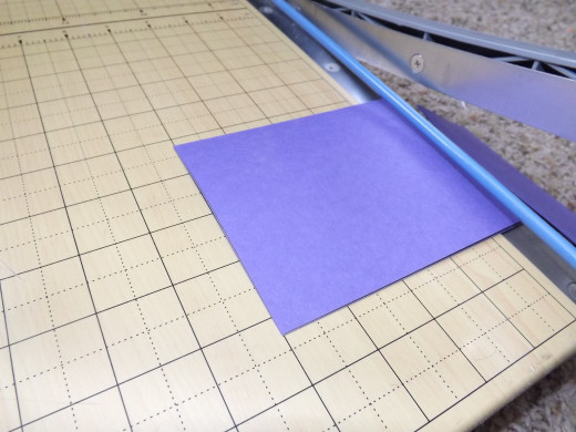 Fold an 8 1/2 x 11-inch piece of cardstock in half lengthwise to get a 4 1/14 x 11-inch piece. From this folded piece, trim away excess to create two 4x6 cards.