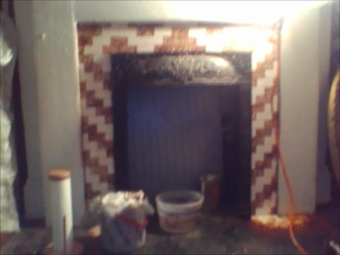 Paint stripped off face of fireplace.  Still working on hearth.