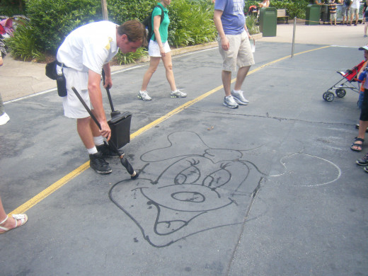 So many people just walked right on by and didn't even notice that he was painting Disney characters using water on the sidewalks.