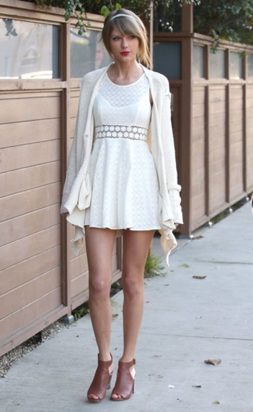 Taylor Swift in a white dress