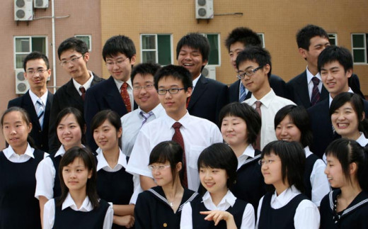 China is the biggest consumer of cell phones.  High school students in the photo.