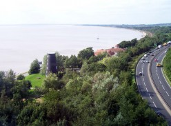 Humber Bank, Hessle, East Riding of Yorkshire, England. Picture taken from the top deck of a No. 350 bus travelling North over the Humber Bridge. The road to the right is the A63 Clive Sullivan Way.