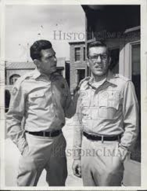 Andy Taylor sternly-rebukes Jerry for the ignorant thing he done when he put the sheriff's deputy uniform on and get involved with troublemakers at the carnival