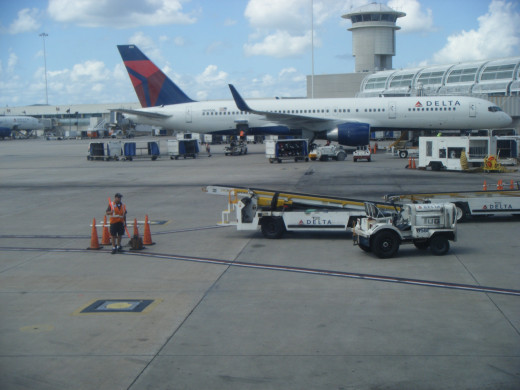 Two Delta Air Lines planes parked at Orlando International Airport (MCO).  The airport is the 13th busiest airport in the U.S. and the 29th busiest in the world.