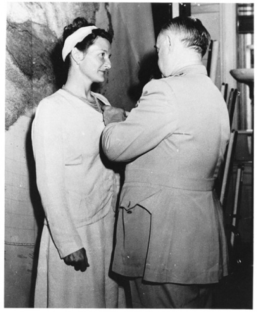 Virginia Hall Receiving the Distinguished Service Cross from General Donovan