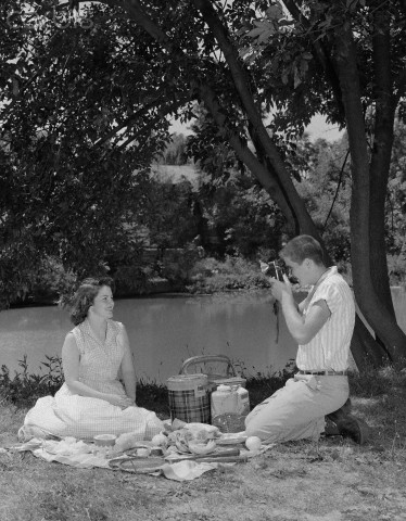 Teenage couple enjoy a picnic date
