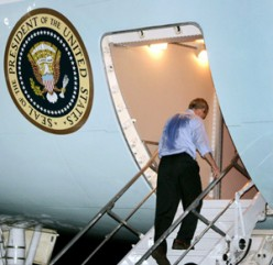 After a hard day's work, (see the president's shirt) President Obama boards Air Force One to head back to Washington, D.C.