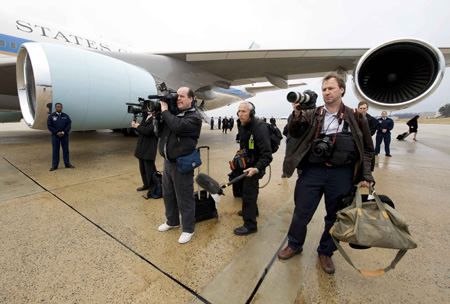 There are always photographers around when Air Force One lands or takes off