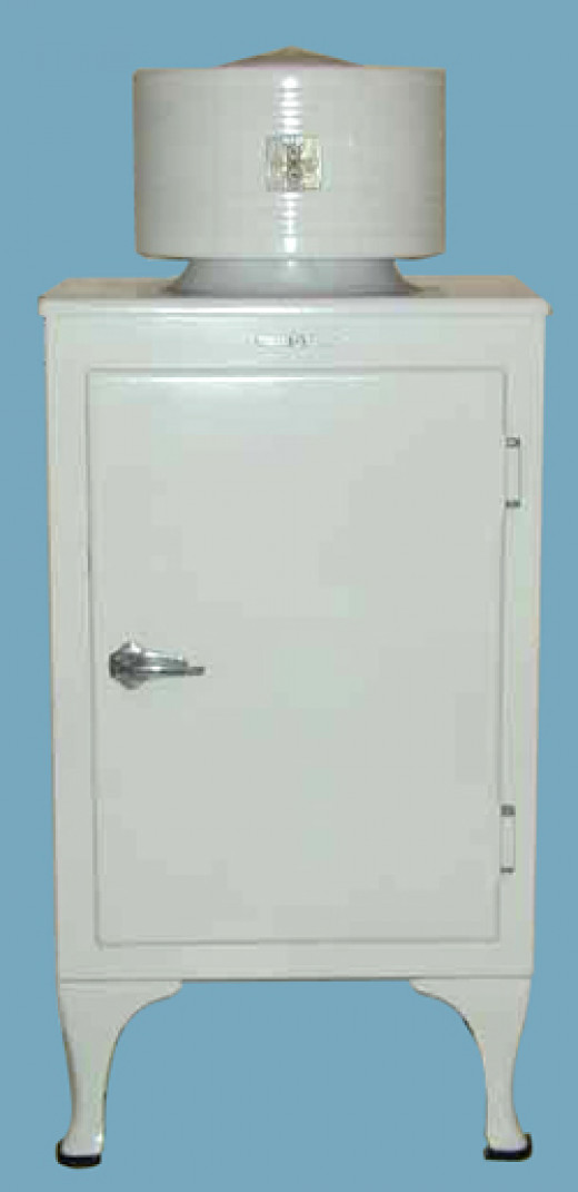 """A General Electric """"Monitor-Top"""" refrigerator.  Introduced in 1927, these units got their name because they were thought to resemble the gun turret on the 1860s ironclad warship, USS Monitor.  This was the first fridge model to see widespread use."""