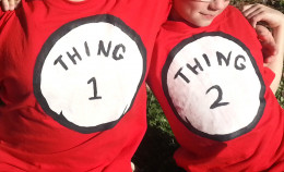 Older brothers add to the decorations with their homemade Thing 1 and Thing 2 shirts.