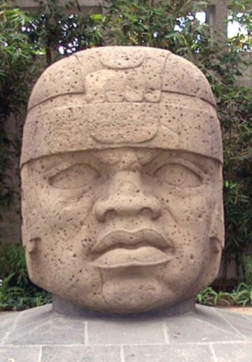 Olmec Nation is thought to be an ancestor of the Mayans in Mexico. The stone heads were a hallmark and full figures often held cacao pods.