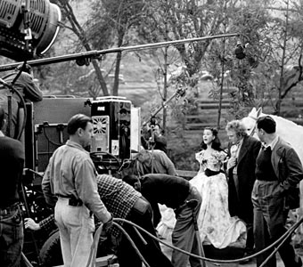 George Cukor, second to the right from Leigh, was the original director of Gone With the Wind.