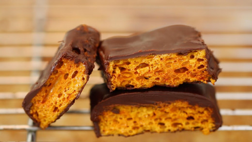 It is easy to coat the home made honeycomb in melted chocolate. Yum!