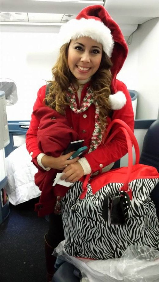 My cute Santa girl appreciated her business class seat to Amsterdam.