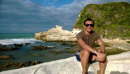 In the background ius the Kapurpurawan Rock Formation located in Burgos, Ilocos Norte