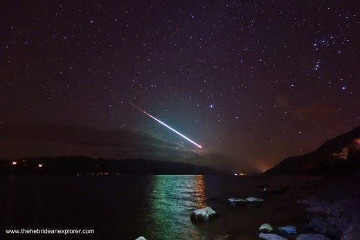 ~ A meteor ( shooting star ) recently captured by chance on St. Patrick's Day, over the rustic, panoramic shores of Loch Ness, cradled within the rugged majesty of the Scottish Highlands, U.K. ~